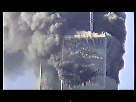 stockvideo's en b-roll-footage met world trade center burning after terrorist attack on september 11 2001 in new york new york - aanslagen op 11 september 2001