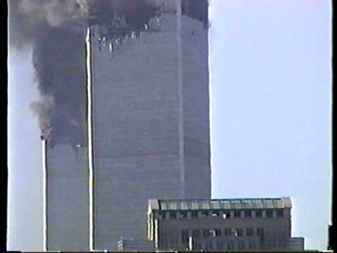 world trade center burning after terrorist attack on september 11 2001 in new york new york - 2001 bildbanksvideor och videomaterial från bakom kulisserna