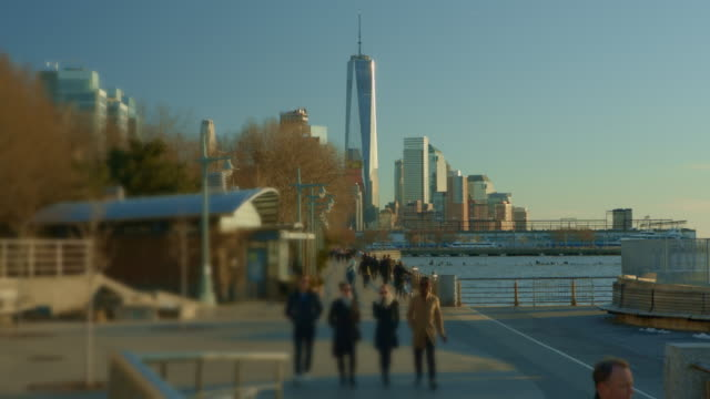 World trade center crowd of people walking in foreground NYC