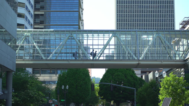 world trade center skybridge with pedestrians - portland oregon stock videos & royalty-free footage