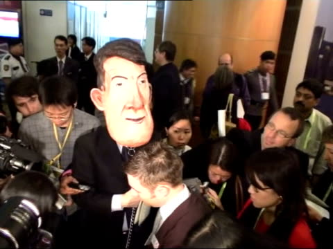 stockvideo's en b-roll-footage met limited deal to help poorer countries group of demonstrators with one man wearing oversized peter mandelson mask - peter mandelson