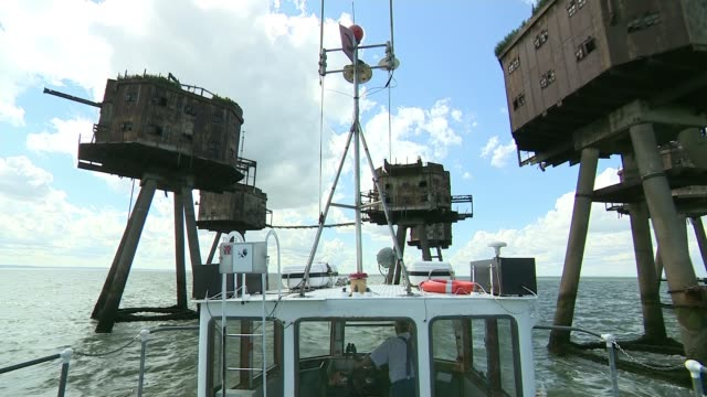 red sands fort falling into disrepair england / at sea thames estuary ext general views red sands fort as seen from moving boat - itv london tonight weekend stock videos & royalty-free footage