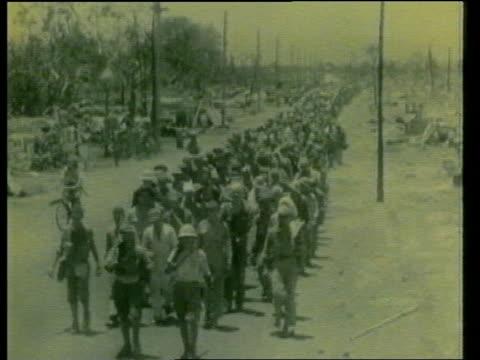 world war 2 veteran attacks prince philip for attending hirohito funeral; tx 18.1.89 / 1940's location unknown: ext tgv line of british soldiers... - 昭和天皇点の映像素材/bロール