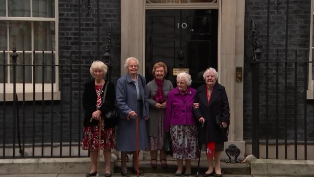 World War 'Canary Girls' who worked in munitions factories visit Downing Street Women who worked in munitions factory posing for photos outside 10...