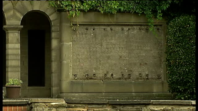 world war i centenary events in london lib broomfield park gv of world war i memorial garden gvs empty spaces on walls after the bronze plaques were... - t in the park stock-videos und b-roll-filmmaterial