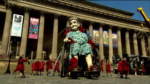 world war i centenary giant puppets telll story of liverpool during the great war england merseyside liverpool ext giant puppet of older woman in... - puppet stock videos & royalty-free footage