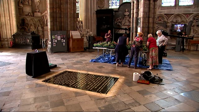world war i centenary: preparations for service at westminster abbey; england: london: westminster abbey: int gvs women preparing flowers in abbey... - tomb of the unknown warrior westminster abbey stock videos & royalty-free footage