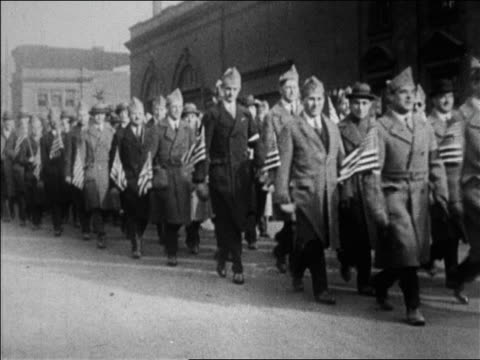 vídeos de stock, filmes e b-roll de world war i veterans marching with us flags at bonus march / brooklyn ny / newsreel - 1923
