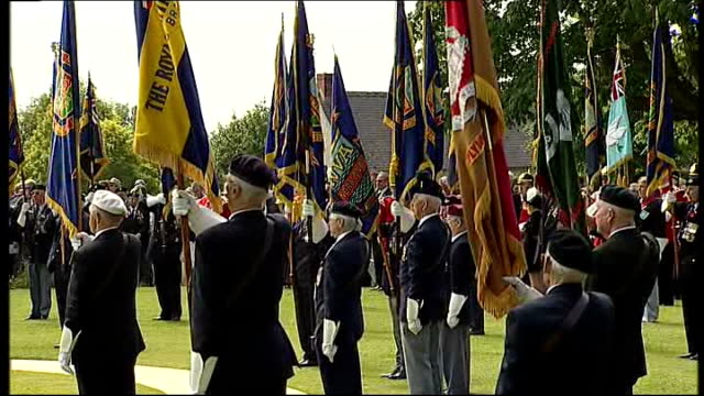 vídeos de stock e filmes b-roll de world war ii 65th anniversary of dday prince charles attends memorial service at bayeux cemetery silence standard bearers rise and lowering of... - baixar