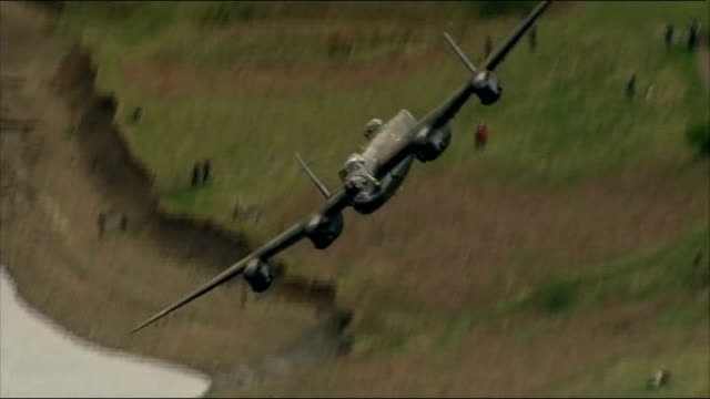 70th anniversary of dambusters raid marked by flypast england derbyshire derwent reservoir lancaster bomber flying over derwent reservoir to mark... - lancaster bomber stock videos & royalty-free footage