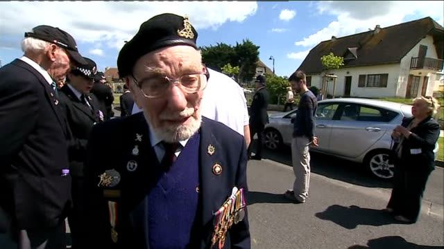 world war ii 70th anniversary of dday landings marked france normandy pegasus bridge ext dday veterans marching along with regimental flags during... - padre stock videos & royalty-free footage