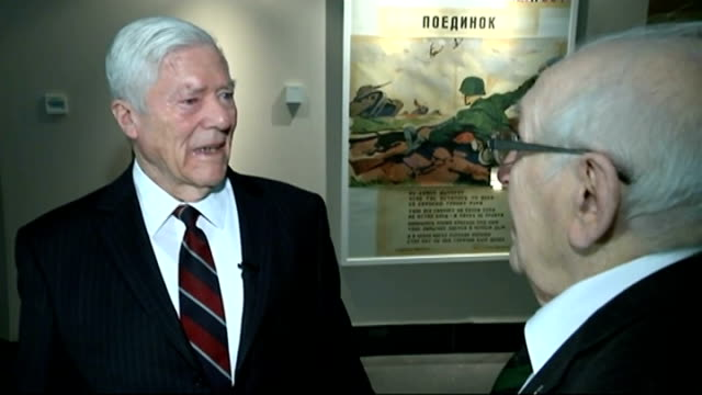 70th anniversary of dresden firebombing; england: int victor gregg shaking hands with frank tolly as they meet for first time/ victor gregg interview... - itvイブニングニュース点の映像素材/bロール