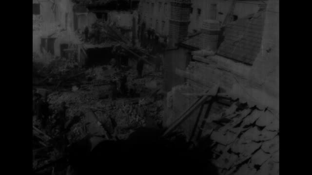 World War II / aftermath of Blitzkrieg bombing in London / destruction and wreckage / Note exact day/month not known film has nitrate deterioration