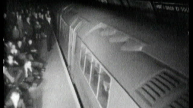 battle of britain 70th anniversary of start of london bombing campaign 1940 b/w footage of tube train arriving at piccadilly circus underground... - 1940 stock videos & royalty-free footage