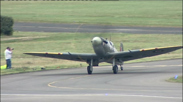 battle of britain 70th anniversary: spitfire planes at biggin hill airport; various shots of spitfire and hurricane planes taxiing then parking... - biggin hill stock videos & royalty-free footage