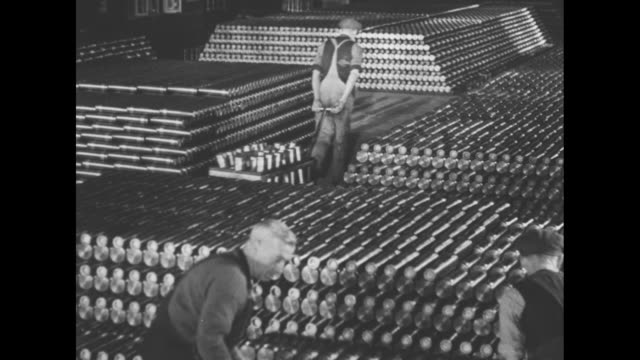 world war ii / behind the guns propaganda film / shells being stacked / ws stack of shells / high angle shot various size shells being manufactured /... - manufacturing stock videos & royalty-free footage