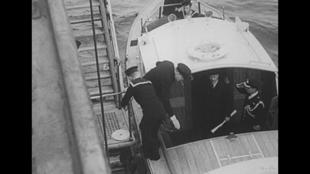 world war ii / british prime minister winston churchill and minister of supply lord beaverbrook disembarking from hms prince of wales / british... - kriegsschiff stock-videos und b-roll-filmmaterial