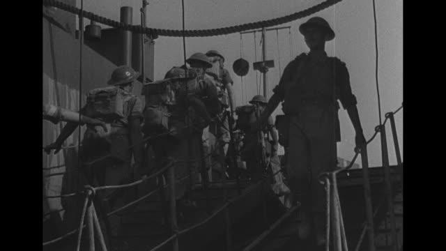 vídeos de stock, filmes e b-roll de world war ii / convoy of shops docked in tunisia / british soldiers boarding ship / troop transports leaving harbor / torpedo shells being loaded /... - world war ii