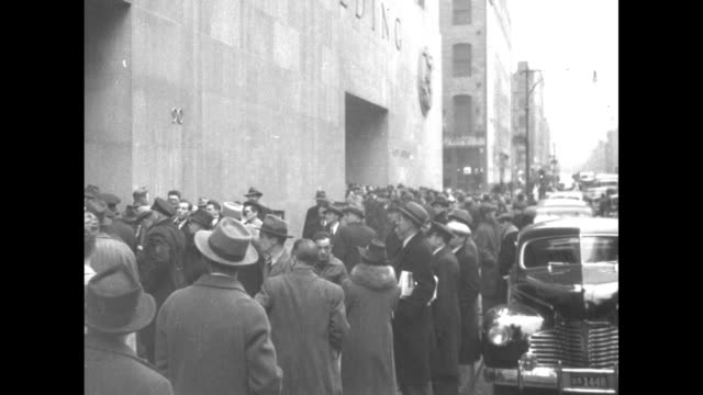 """world war ii / crowds and traffic outside the federal office building / people hold up newspapers with headline """"japan at war with us"""" / recruitment... - military recruit stock videos & royalty-free footage"""