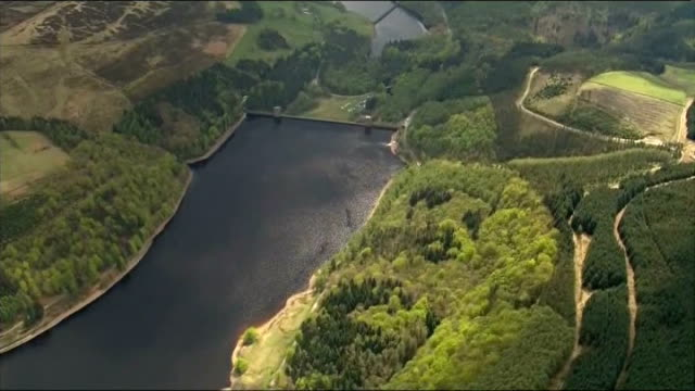 dambusters 70th annivesary flypast aerials england derbyshire derwent reservoir derwent reservoir and surrounding hills/ spitfire flypast over... - lancaster bomber stock videos & royalty-free footage