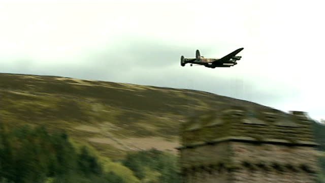 dambusters 70th annivesary flypast england derbyshire derwent reservoir ext crowds alongside reservoir awaiting flypast/ spitfire flypast over... - lancaster bomber stock videos & royalty-free footage