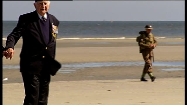 dunkirk 70th anniversary ceremony remembers those left behind france dunkirk ext man in world war ii british army uniform walking on deserted beach... - ramsgate stock videos & royalty-free footage
