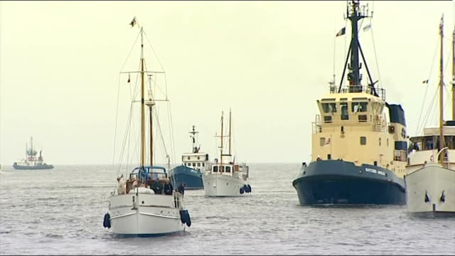 dunkirk 70th anniversary little ships arrive in dunkirk man on dockside plays bagpipes as ships sail into harbour sot/ crew on deck on blue bird as... - segelmannschaft stock-videos und b-roll-filmmaterial