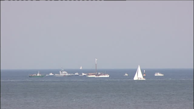 dunkirk 70th anniversary service on dunkirk beach france dunkirk ext little ships gathered offshore to mark the 70th anniversary of the evacuation of... - allied forces stock videos and b-roll footage