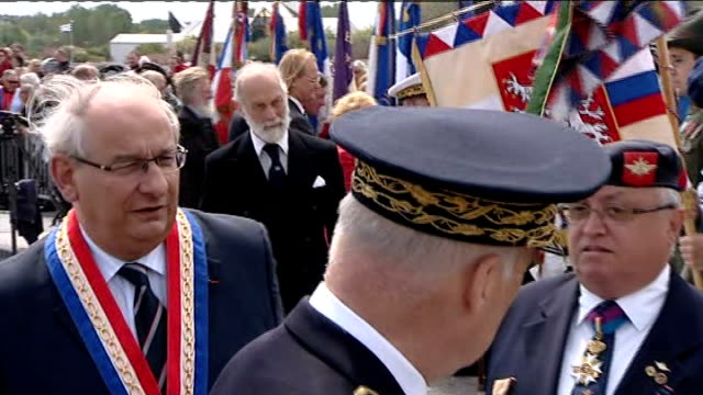 Dunkirk 70th anniversary service on Dunkirk beach Belgian veterans with flags / Prince Michael of Kent meeting veterans