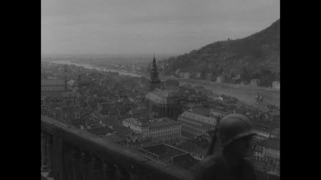 world war ii / european theater / germany / aerials of heidelberg / us flag on pole with nazi eagle emblem on top / us troops walking on heidelberg... - påle bildbanksvideor och videomaterial från bakom kulisserna