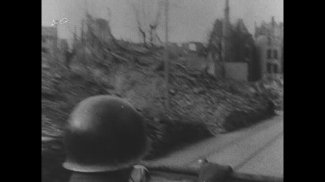 World War II / European theater / Germany / sign Frankfurt 8km / French language / smoke over Frankfurt / US troops taking cover near a tank / tanks...