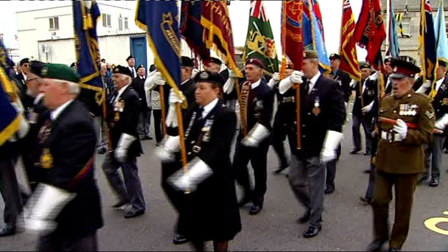eve of dunkirk anniversary ramsgate parade world war ii veterans stand to attention bearing regimental flags/ world war ii military vehicles trucks... - ramsgate stock videos & royalty-free footage
