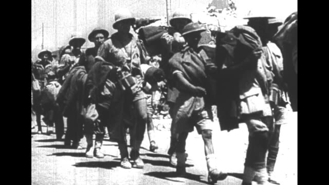 world war ii / french language / captured soldiers march with hands up / troops moving out, walking through civilian crowded streets of port city /... - french language stock videos & royalty-free footage