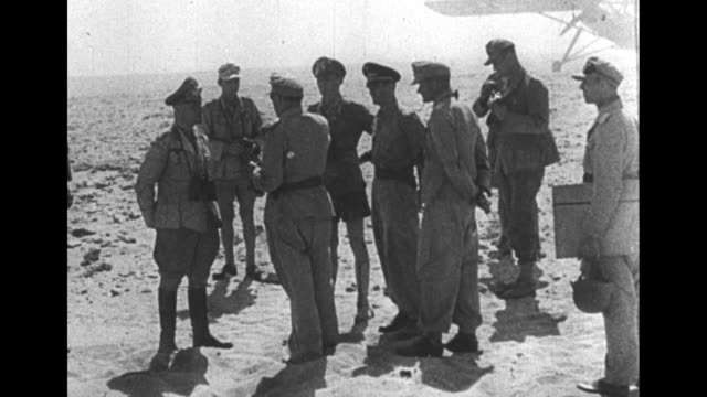 vídeos de stock, filmes e b-roll de world war ii / french language / north africa campaign / german field marshal erwin rommel getting out of car, joining other german officers / german... - áfrica do norte