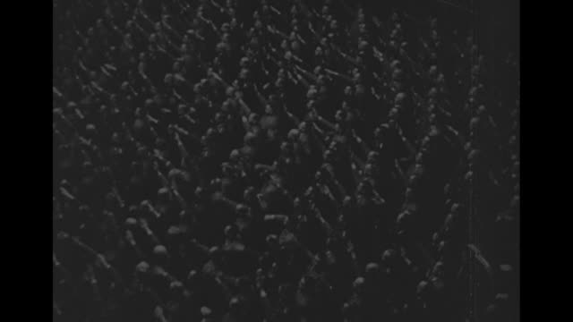 world war ii / full reichstag stand to give nazi salute / adolf hitler sitting / audience rises to give nazi salute / hitler takes the stage amid... - war stock videos & royalty-free footage