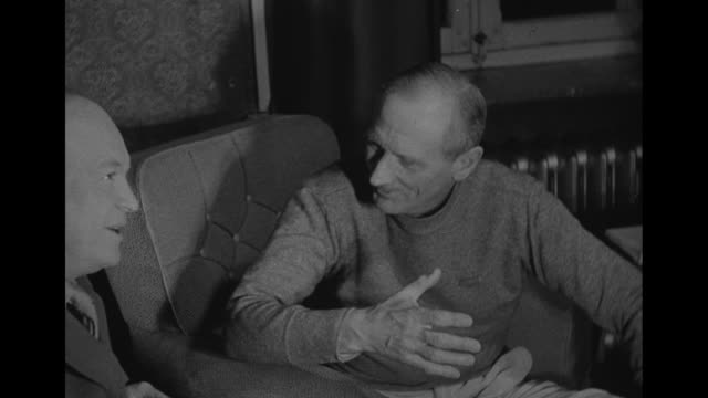 world war ii / general dwight eisenhower seated and laughing with british general bernard montgomery / note exact day not known - generale grado delle forze armate video stock e b–roll