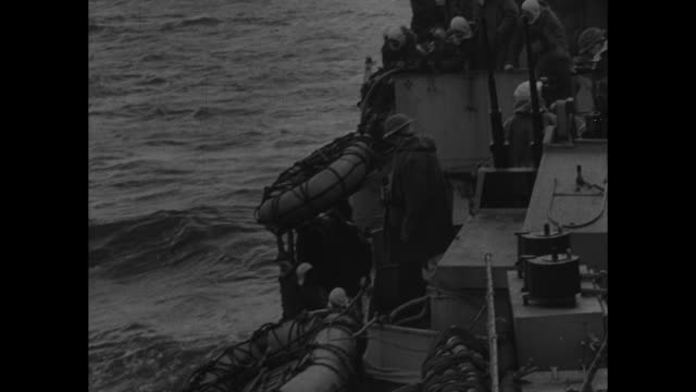 world war ii /hmcs algonquin taking wounded on board / canadian landing craft with wounded pulls up to algonquin / wounded are offloaded by stretcher... - normandy stock videos & royalty-free footage