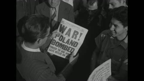 world war ii / homefront / men looking up at times square moving sign / man reading newspaper about germany invading poland / other headlines all... - poland stock videos & royalty-free footage