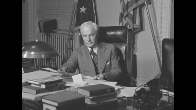 world war ii / homefront / secretary of state cordell hull sits at desk / cu hull / hull sitting with under secretary of state sumner welles / cu... - cordell hull stock videos and b-roll footage