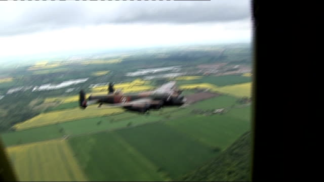 lancaster bomber flies over reservoir on dambusters' anniversary air to air various of lancaster bomber in flight - lancaster bomber stock videos & royalty-free footage