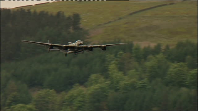 lancaster bomber flies over reservoir on dambusters' anniversary good shot lancaster bomber plane flying along - lancaster bomber stock videos & royalty-free footage