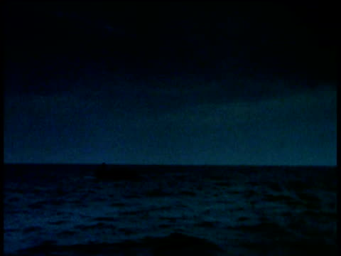 World War II Lifeboat in great expanse of choppy dark blue waters