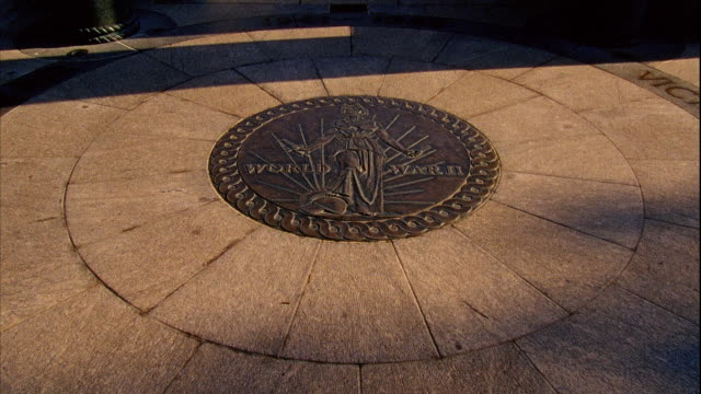 ms world war ii memorial plaque on sidewalk tu reveals fountain pillars standing distant bg - memorial plaque stock videos and b-roll footage