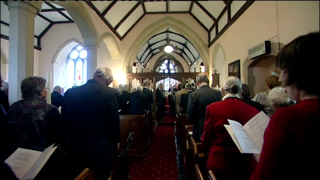 memorial service for pegasus bridge veteran devon congregation singing during memorial service sot man reading speech at lectern sot - pegasus stock videos & royalty-free footage