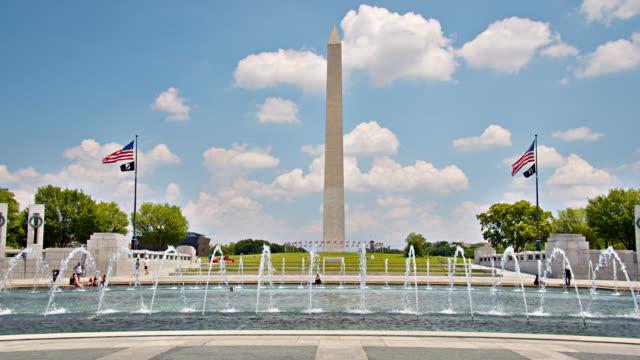 world war ii memorial. washington monument. american flag - war memorial stock videos & royalty-free footage