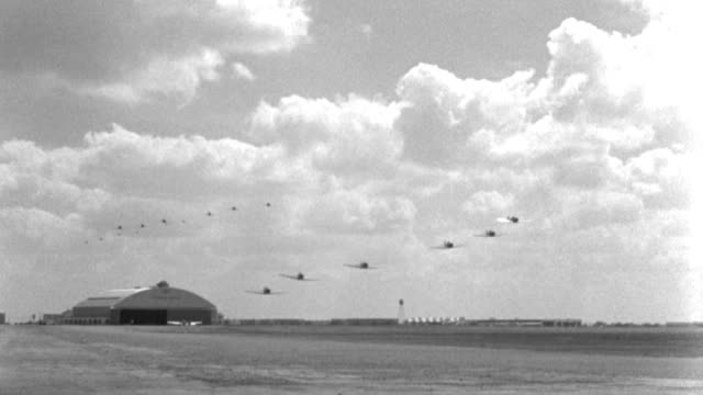 world war ii military planes fly in formation for their training graduation aerial review. - 1940 video stock e b–roll