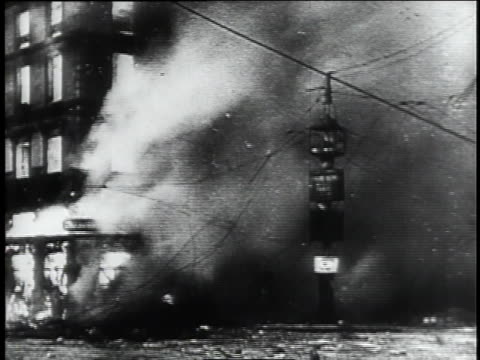 world war ii military planes fly past a barrage balloon; bombed buildings collapse in flames; evacuees leave in trucks and cars; parisian mothers tearfully say goodby to their children who are being evacuated. - world war ii stock videos & royalty-free footage