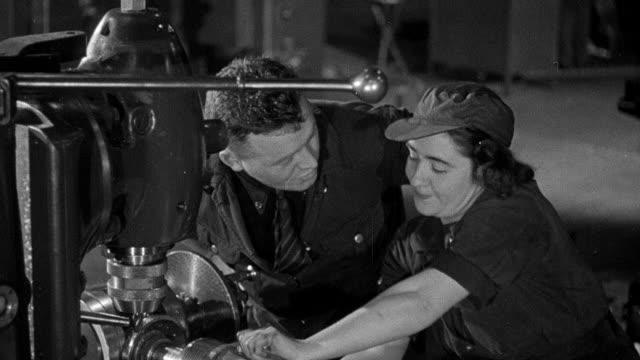 vídeos y material grabado en eventos de stock de b/w montage world war ii munitions factory workers boring gun barrels and operating machinery / england, united kingdom - grupo mediano de personas