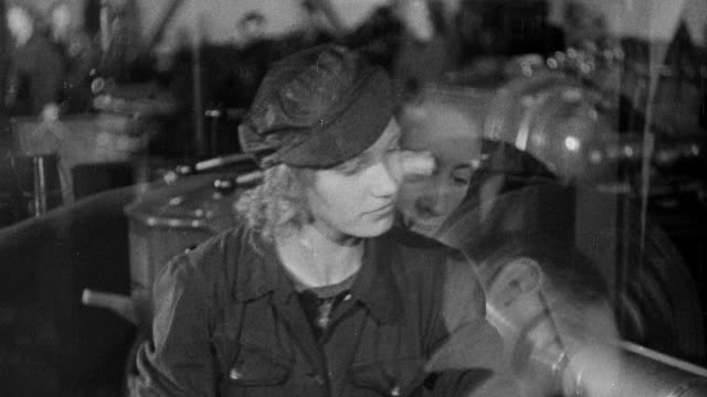 b/w montage world war ii munitions factory workers operating equipment, sweeping metal shavings from floor, and discussing being tired / england, united kingdom - world war ii video stock e b–roll