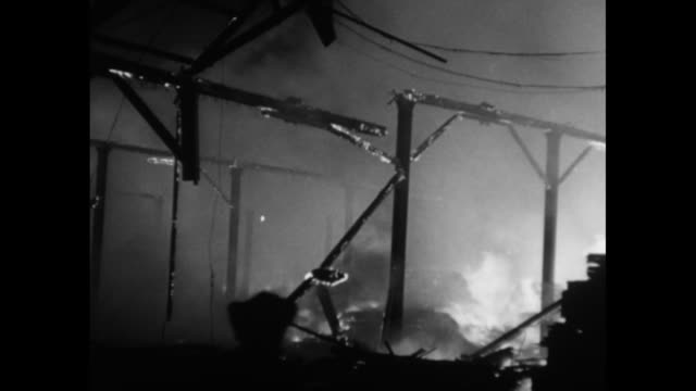 world war ii / night / blitzkrieg / fires and smoke / buildings on fire in london / firefighters watch buildings burn /note: exact day not known - burning stock videos & royalty-free footage